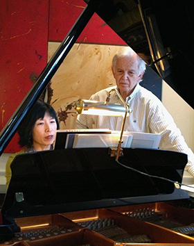Gloria Cheng rehearsing with Bruce Broughton