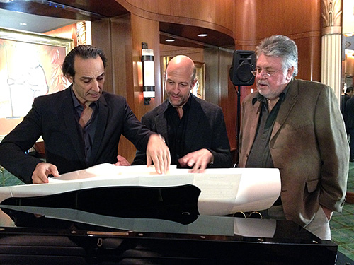 Alexandre Desplat, pianist Randy Kerber, and SCL President Ashley Irwin review excerpts from Desplat's scores. (Photo by Marilee Bradford)
