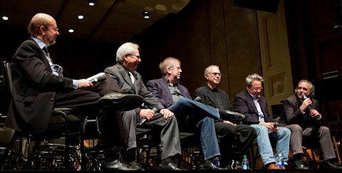 (Left to right) Moderator Jon Burlingame, music editor Kenneth Hall, agent Richard Kraft, music mixer Bruce Botnick, and film directors David Anspaugh and Joe Dante in a panel discussion during the Goldsmith Project afternoon symposium sponsored by The Film Music Society. (Photo by Philip Holahan.)