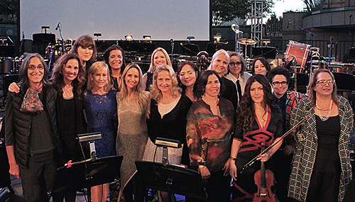 The women who score! Back row, from left: Heather McIntosh, Kathryn Bostic, Julia Newmann, Penka Kouneva, Lolita Ritmanis, Lisa Coleman, Lesley Barber, Nora Kroll-Rosenbaum. Front row, from left: Miriam Cutler, Starr Parodi, Nan Schwartz, Sharon Farber, Wendy Blackstone, Germaine Franco, Lili Haydn, Laura Karpman.
