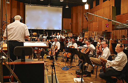Conductor Tim Simonec instructs the orchestra during an \'Apes\' session on the Newman Scoring Stage at 20th Century Fox.