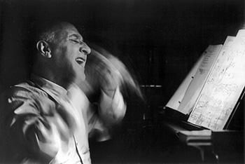 Dimitri Tiomkin rehearsing the score for 'Giant' (Photo by Allan Grant)