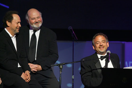 Billy Crystal and Rob Reiner barely contain their laughter as Shaiman