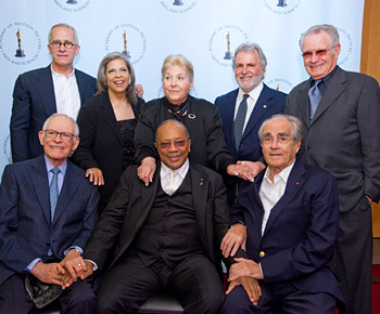 From left to right: (seated) Alan Bergman, Quincy Jones, Michel Legrand; (standing) James Newton Howard, Patti Austin, Marilyn Bergman, Sid Ganis and Dave Grusin. (Photo credit: Todd Wawrychuk / ©A.M.P.A.S.)