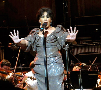 Dame Shirley Bassey sings the theme from <i>Goldfinger</i>.